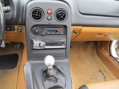 Alpine radio and VooDoo shift knob. Also plug for CB radio