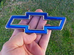 Chevy Bowtie idea.  I like this one where the blue part would be a raised area, kind of like embossed on the wrench.