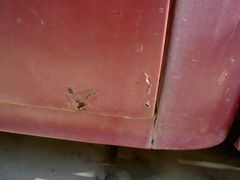 Driver side rear lower door rust