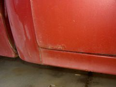 Pass. side rear lower door rust